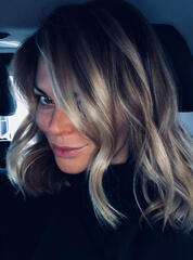 Lisa Marie Bourke in a car with curled hair
